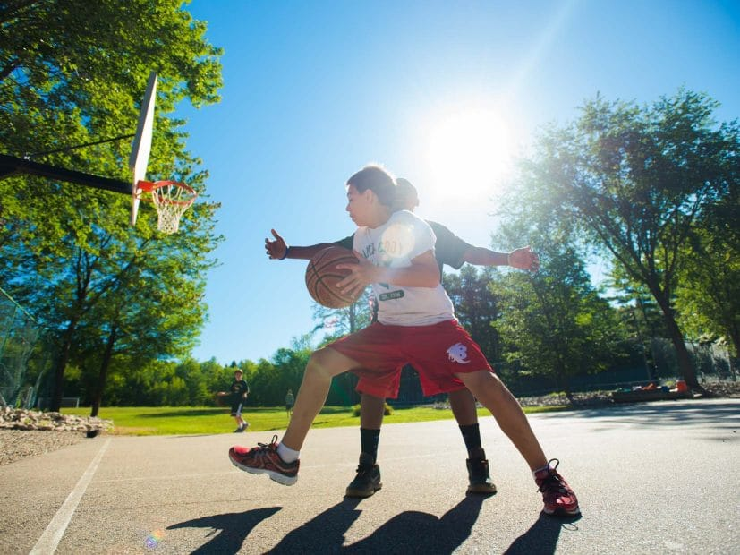 two boys playing basketball