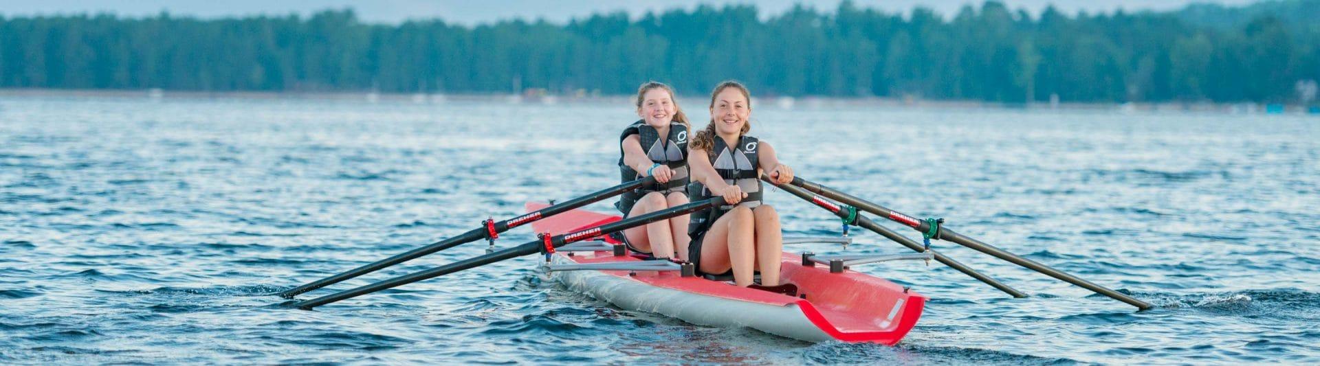 girls rowing in a canoe