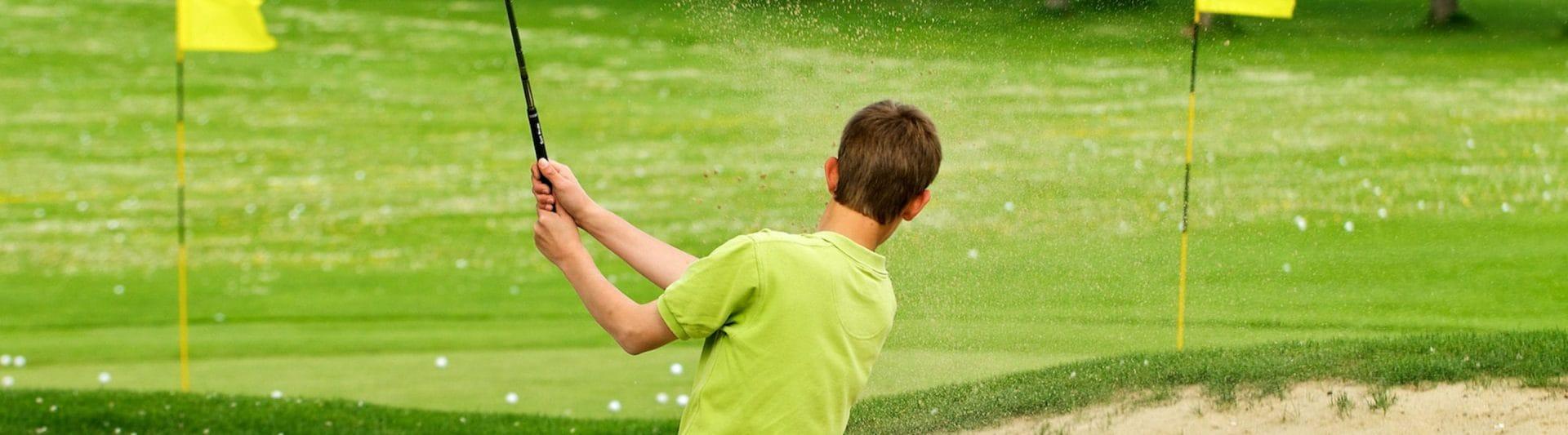 boy golfing