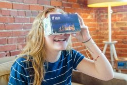 young girl looking at a camp cody virtual reality kit box